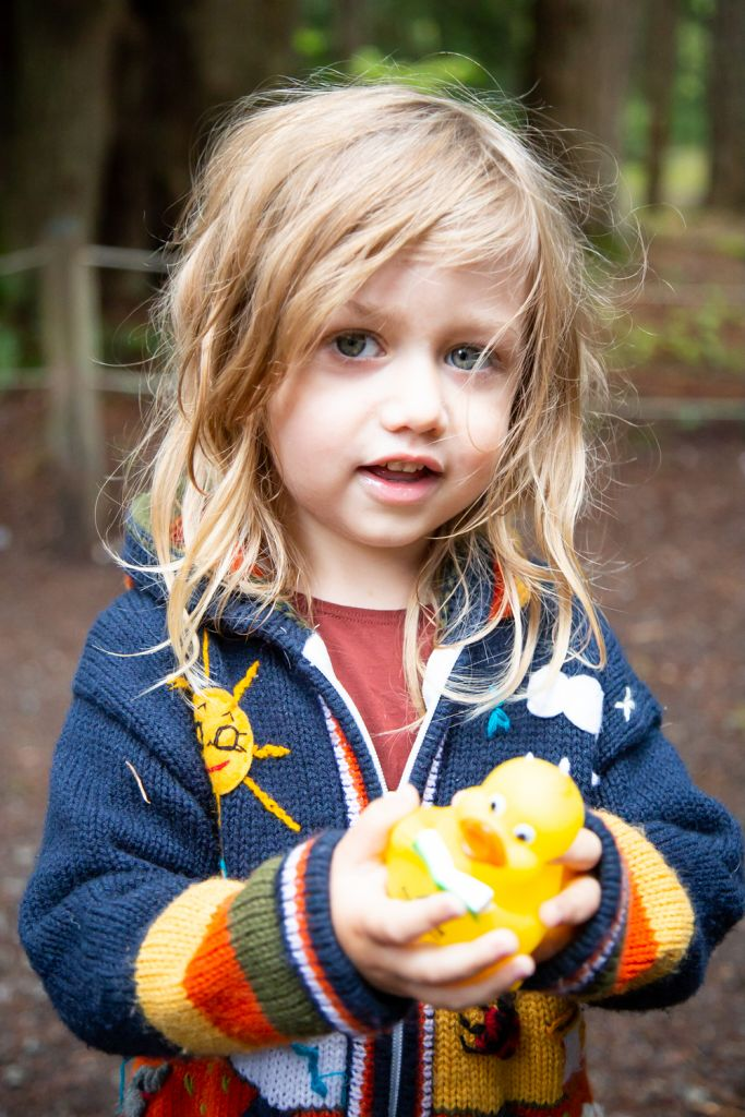 Small child with Accent Inns duck