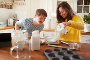 Mother and son bake together