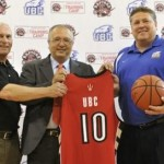 UBC and Raptors staff hold up jersey to announce training camp