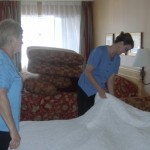 Mandy Farmer & Joan making a bed at the Accent Inn Victoria Hotel