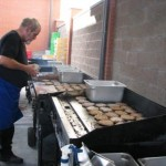 Lions club serving hamburgers at project connect