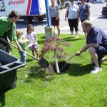 Mandy farmer and team tree planting at accent inns kelowna hotel
