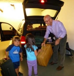 Terry farmer's Grandkids helping Granpa to load car