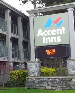 Accent Inn Victoria sign we're open after ABC fire