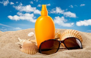 Sunscreen-and-Sunglasses-on-the-Beach