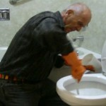 Accent Inns Founder Terry Farmer seen cleaning a hotel room toilet. online reviews