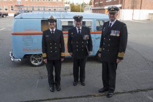 Honorary Captain (N) (HCapt (N)) Mandy Farmer pose in front of her Hotel Zed company van with Base Commander Captain (N) Steve Waddell, and Chief Petty Officer 1st Class (CPO1) Gino Spinelli, Base CPO, at the commencement of Canadian Forces Base (CFB) Esquimalt's Base Divisions held at the Naden Drill Shed on 27 September 2016. Image by LS Ogle Henry, MARPAC Imaging Services ET2016-0362-02 © 2016 DND-MDN Canada